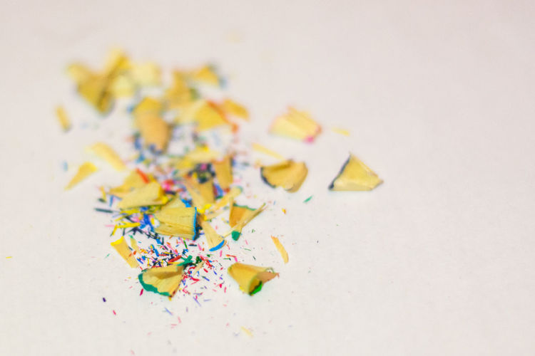 Close-Up Of Pencil Shavings Against White Background