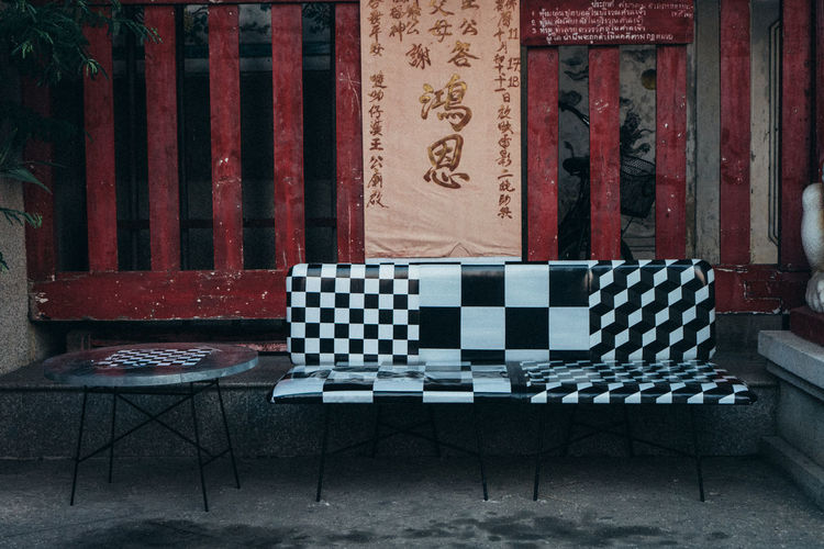 Indoors  No People Pattern Seat Chair Table Absence Leisure Games Relaxation Architecture Flooring Empty Building Wood - Material Home Interior Wall - Building Feature Red Built Structure Day Checked Pattern Floral Pattern