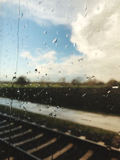 Window Glass - Material Drop Transparent Wet Rain Water Sky Nature Cloud - Sky Transportation Mode Of Transportation RainDrop Rainy Season Glass