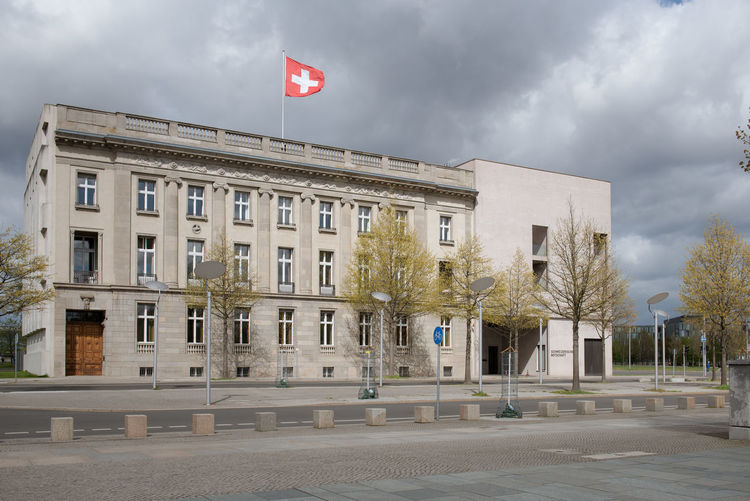 Swiss Embassy in Berlin, Germany. Berlin Foreign Affairs Architecture Botschaft Building Building Exterior Built Structure City Cloud - Sky Day Embassy Flag Government Nature No People Outdoors Patriotism Plant Sign Sky Street Swiss Embassy Switzerland Tree Window