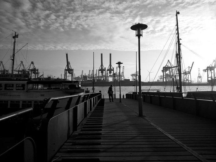 Man walking on pier at dock