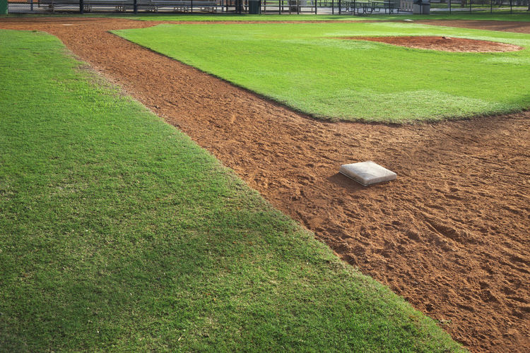 Baseball infield from first base side in morning light Baseball Field Dirt Grass Green Color Sport Sunlight Youth Outdoors No People Photography Infield First Base Base Path Mound