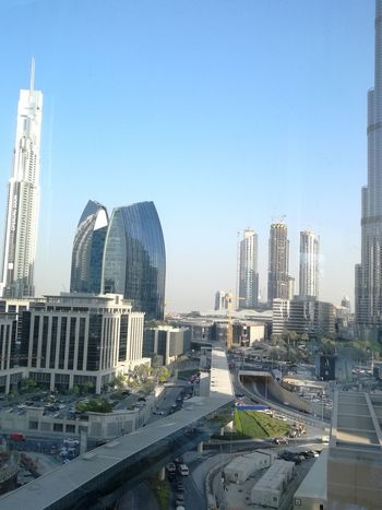 City Skyscraper Architecture Modern Travel Destinations Cityscape Clear Sky Urban Skyline No People Outdoors Sky Downtown District Downtown Dubai Infrastructure Network Urban Landscape