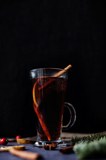Mulled wine, cinnamon sticks and berries on the wooden table Food And Drink Drink Mulled Wine Household Equipment No People Black Background Glass Hot Drink Freshness Coffee Drinking Glass Refreshment Cinnamon Sticks Winter Drinks Still Life Close-up Indoors  Tea - Hot Drink Wine Red Wine Copy Space Fruits