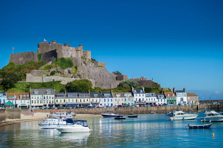 Blue Boat Clear Sky Day Fort Gorey Gorey Castle Harbor Jersey Outdoors Tourism Town Travel Destinations Water