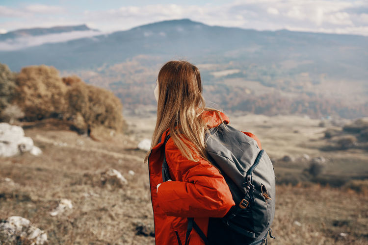 Side view of woman looking at mountain range