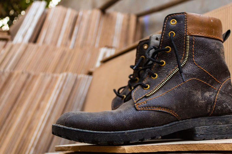 Shoe No People Leather Close-up Pair Boot Wood - Material Brown Indoors  Selective Focus Shoelace Focus On Foreground Clothing Still Life Seat Flooring Absence Business Personal Accessory Menswear Lace - Fastener