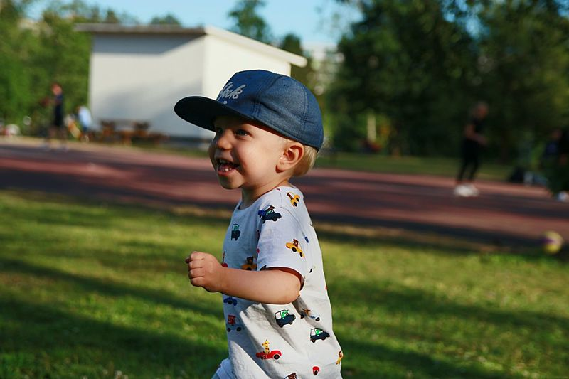 Cheerful boy running outdoors