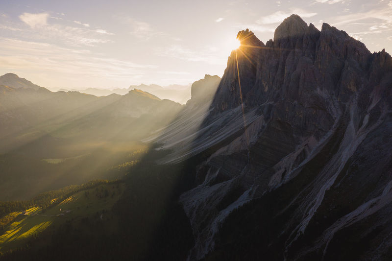 Early morning sun rays burst from behind Seceda in the Italian Dolomites. DJI Mavic Pro Dolomites, Italy Drone  Light Rays Aerial Photography Aerial View Beauty In Nature Drone Photography Environment Formation Italy Mavic Pro 2 Mountain Mountain Peak Mountain Range Nature Outdoors Scenics - Nature Seceda Shadows Sky Sunbeam Sunrise_sunsets_aroundworld Travel Week On Eyeem A New Beginning Autumn Mood A New Perspective On Life Capture Tomorrow