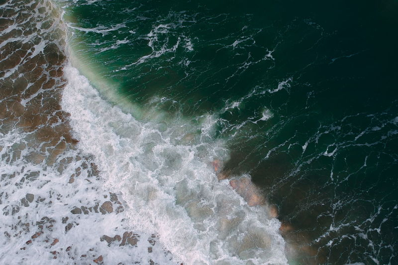 aerial view of sea waves water texture background Motion Sea Water Sport Surfing Aquatic Sport Wave Beauty In Nature Nature Land High Angle View Day Power Outdoors Power In Nature Beach Scenics - Nature Blurred Motion Breaking Flowing Water