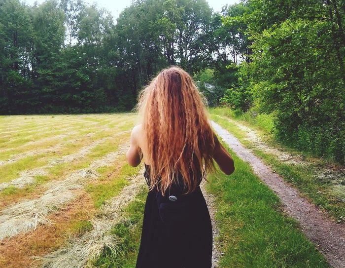Long Hair Rear View Real People One Person Day Lifestyles Leisure Activity Women Grass Field Nature Standing Green Color Outdoors Tree Growth Young Women Young Adult Adult People