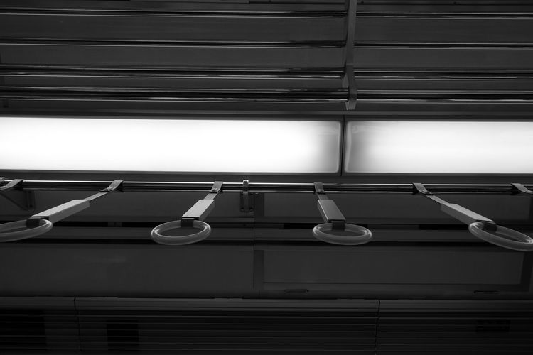 Low angle view of illuminated lamps