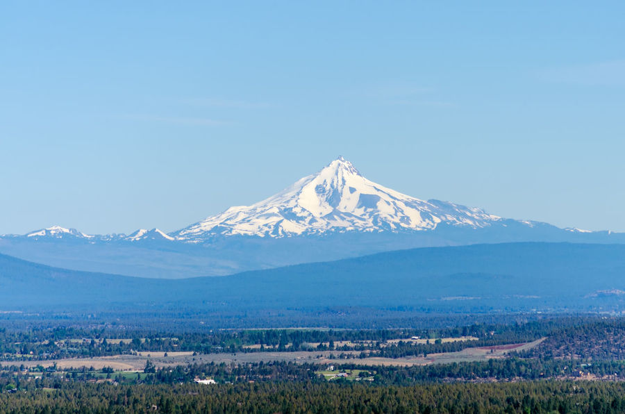 View of Mount Jefferson, one of the volcanoes of the Cascade Range Bend Blue Calm City Deschutes Forest Grass Landscape Mount Jefferson Mountain Nature Oregon Outdoors Panoramic Park Scene Sky Tourism Town Travel United States View Volcano Volcanoes Wood