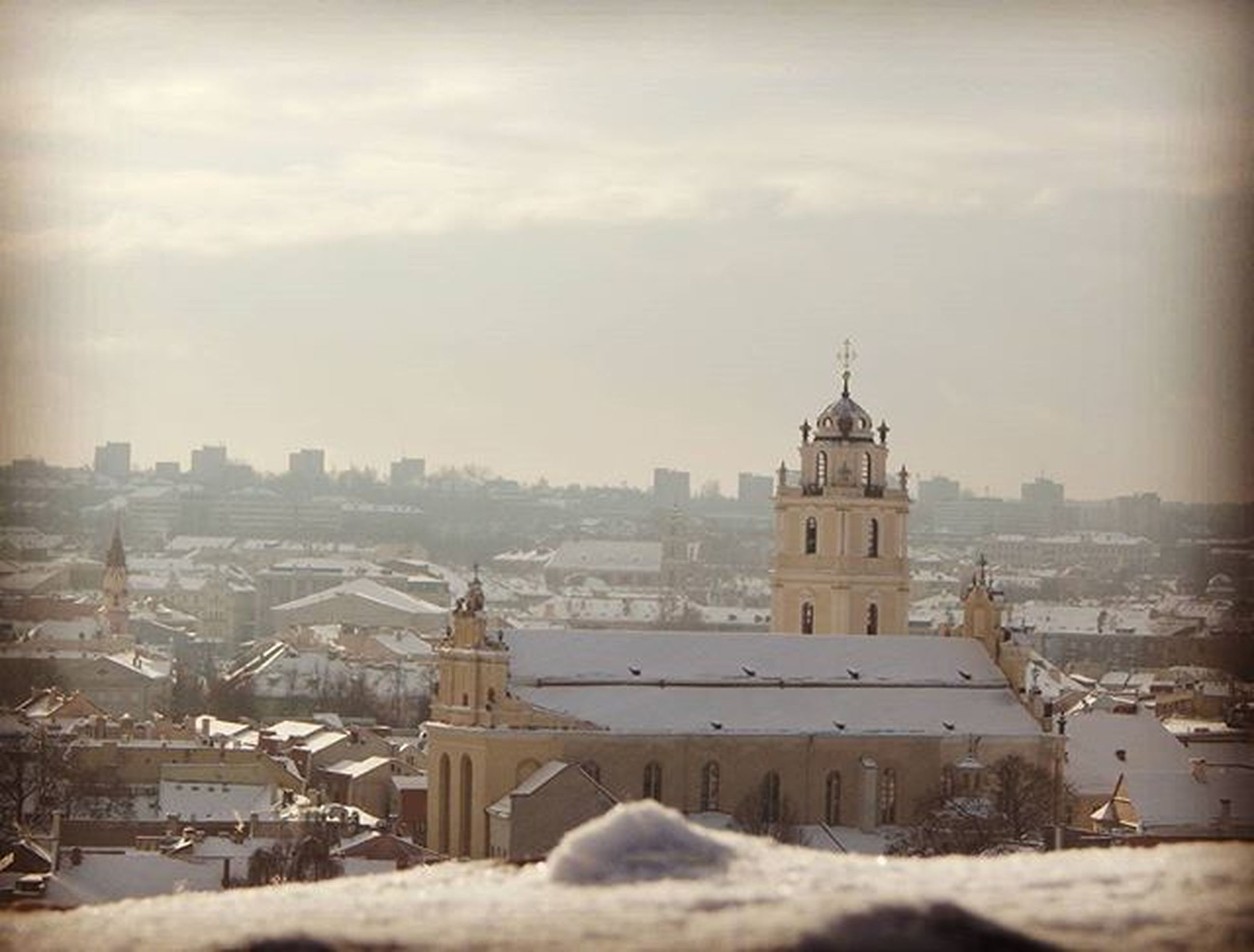 building exterior, winter, architecture, snow, cold temperature, built structure, weather, season, city, cityscape, sky, covering, religion, church, cloud - sky, place of worship, high angle view, residential structure, frozen, residential building