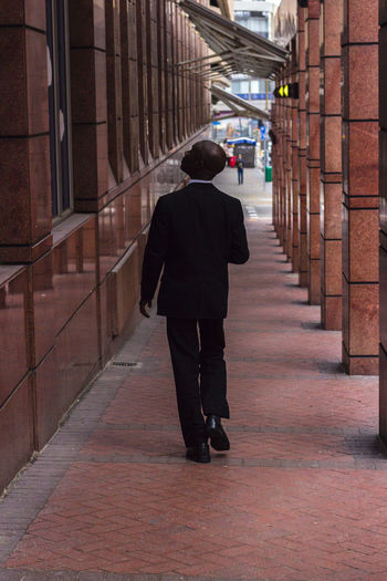 Man walking from behind Adult Adults Only Cape Town Day Full Length Man In Suit Man In Suit Walking Man Walking Man Walking From Behind Men One Man Only One Person Only Men Outdoors People Rear View South Africa