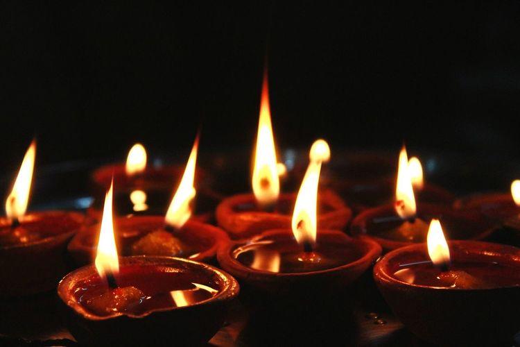 Diyas Diya - Oil Lamp Black Background Diwali Oil Lamp Flame Spirituality Heat - Temperature Celebration Religion Burning Fire - Natural Phenomenon Glowing Sparks Entertainment Firework - Man Made Object Sparkler Exploding Light Painting Darkroom Lit EyeEmNewHere