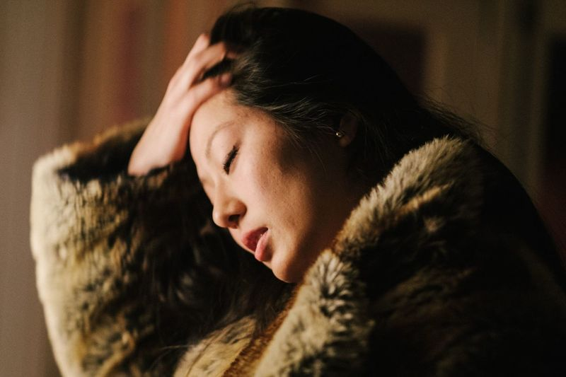 Brazilian Japanese Indoors  One Person Eyes Closed  Young Adult Close-up Headshot Real People Relaxation Beautiful Woman Lifestyles Women Asian  The Week Of Eyeem Netherlands Artist EyeEm Best Shots Portraits Fur Coat Portrait Of A Woman Young Women Mood