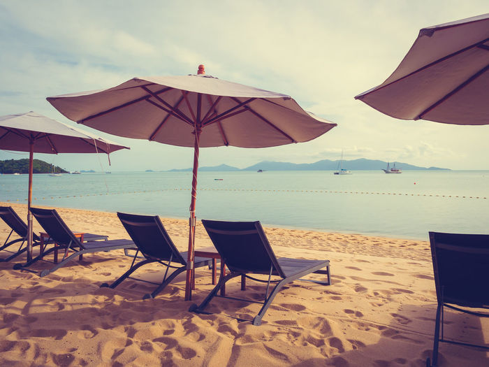 Absence Beach Beach Umbrella Chair Horizon Over Water Land Nature No People Outdoors Parasol Protection Sand Sea Seat Security Shade Sky Tranquil Scene Tranquility Umbrella Water