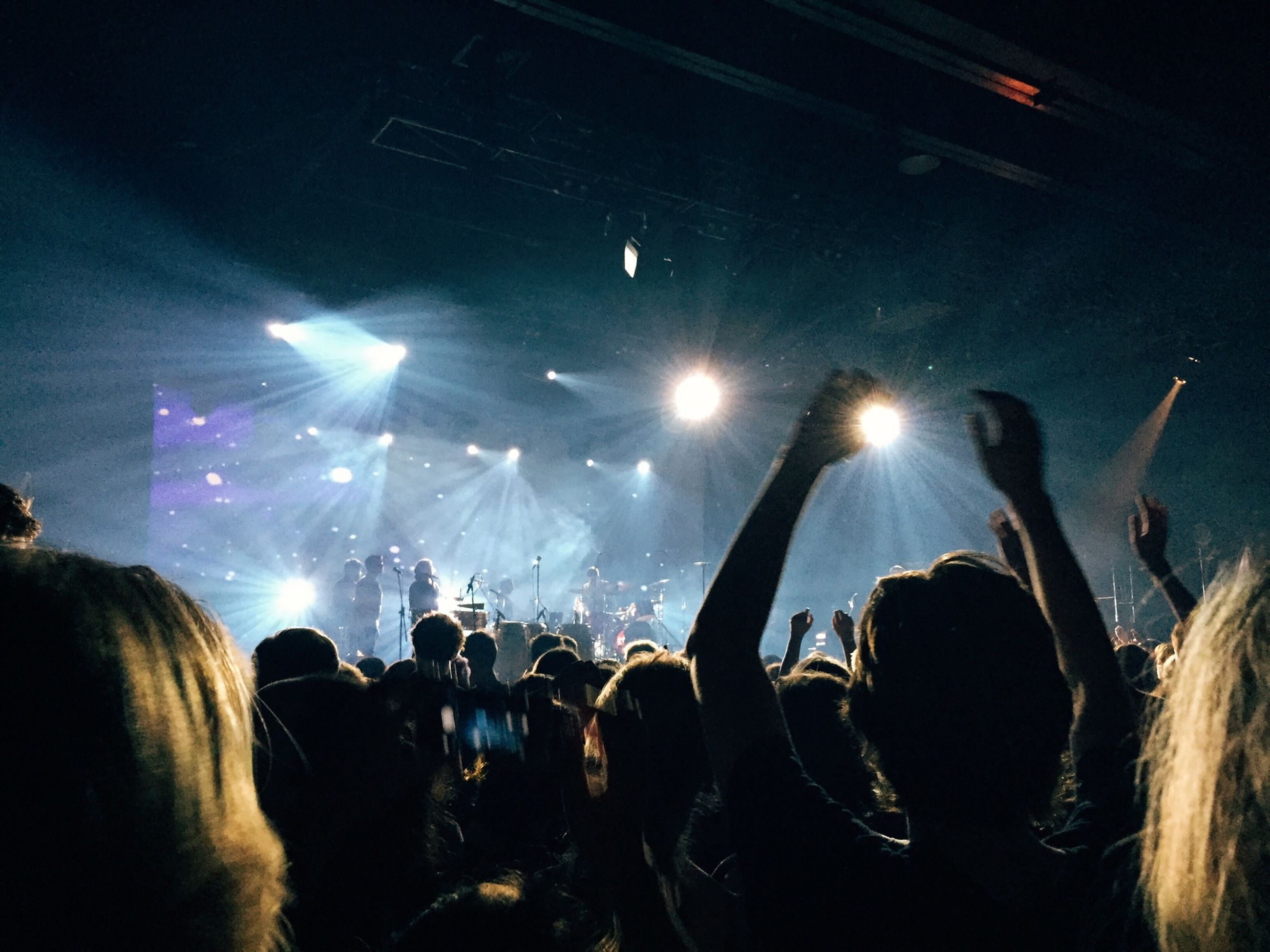 large group of people, arts culture and entertainment, music, crowd, lifestyles, nightlife, enjoyment, person, men, illuminated, leisure activity, performance, stage - performance space, event, fun, youth culture, concert, music festival, popular music concert