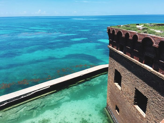 Walking on the top of Fort Jefferson at the Dry Tortugas Aqua Water Dry Tortugas Fort Jefferson Beautiful Day Blue Sky Blue Water Carribean Carribean Sea Moated Castle Moat Brick Building Old Fort Historic Ocean Water Sea Nature No People Tranquility Sunlight Outdoors Tranquil Scene Beauty In Nature