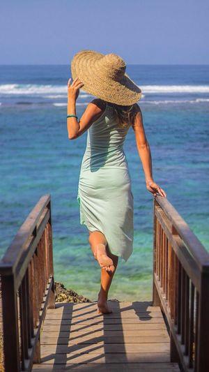 MeMyself&I Life Is A Beach Sea And Sky Sea View Blue Wave Blue Water Blue Sea Sky And Clouds Beachphotography Beach Bridge Hat Girl Life Is Beautiful Amazingindonesia Bali, Indonesia Seaandsun Woman Women Of EyeEm People Photography Midday Sunlight Ocean View Seascape