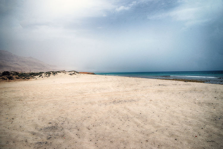 Sky Sea Beach Land Water Scenics - Nature Beauty In Nature Tranquility Cloud - Sky Sand Tranquil Scene Horizon Horizon Over Water Nature Day Non-urban Scene No People Environment Outdoors