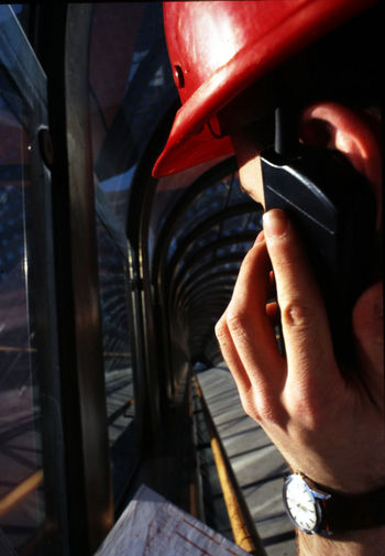 Close-Up Of Manual Worker Talking On Phone