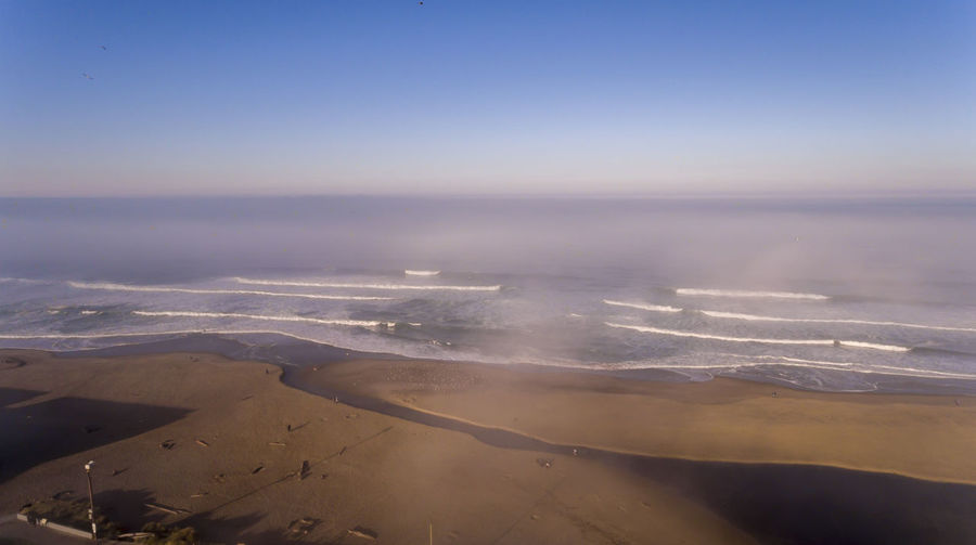 Aerial view of the beach in Lincoln City Oregon Scenics - Nature Sky Aerial View Beauty In Nature Environment Tranquil Scene Nature Tranquility Landscape Water Sea Outdoors No People High Angle View Horizon Day Power In Nature Oregon Pacific Northwest  Ocean Beach Fog Coast Blue River
