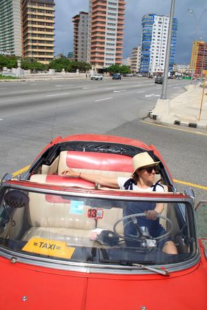Cuba Habana Havana Havanna, Cuba In A Car Road Cabrio Car City Cuban Cars Cuban Life Havana Street Land Vehicle Old Car One Person Red Cabrio Red Car Sunglasses Transportation Vintage Cars Young Adult Young Women Done That. Stories From The City