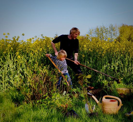 Gardening Two People Childhood Togetherness Child Innocence Nature Full Length Bonding Growth Family Portrait Gardening Gardening Tools Happiness Day People