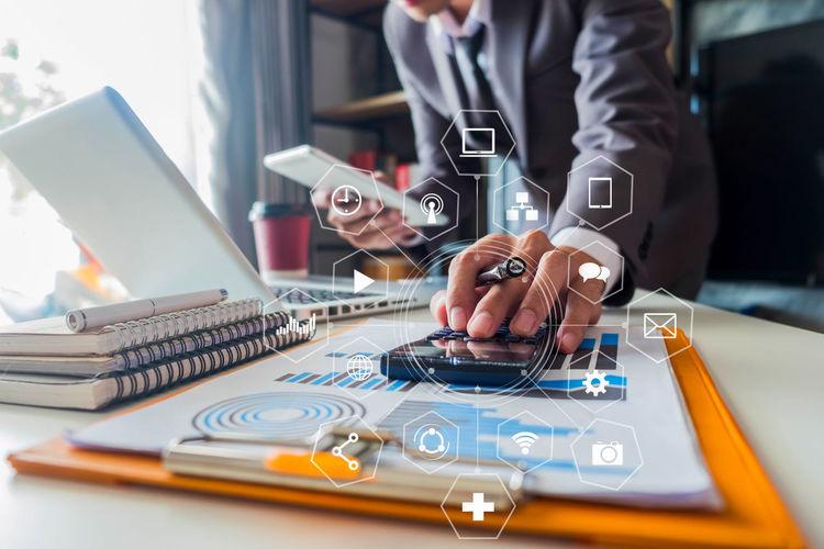 Digital Composite Image Of Businessmen Working In Office