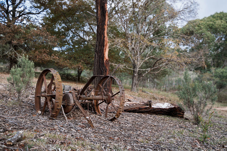 Old abandoned machinery on field