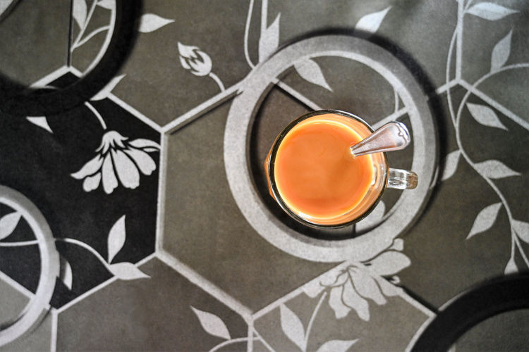 Food And Drink Refreshment Indoors  Drink Food Orange Color High Angle View Cup No People Table Mug Close-up Tea Freshness Glass Healthy Eating Tea - Hot Drink Directly Above Orange Hot Drink Floral Pattern Tea Cup Crockery