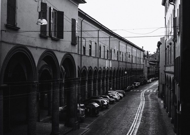 Bologna Transportation Mode Of Transportation Building Exterior Architecture Built Structure Land Vehicle Adventures In The City Train Public Transportation Rail Transportation Train - Vehicle Travel Clear Sky Street City No People Outdoors Sky In A Row Day Nature The Traveler - 2018 EyeEm Awards