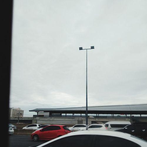 Cars on street against sky