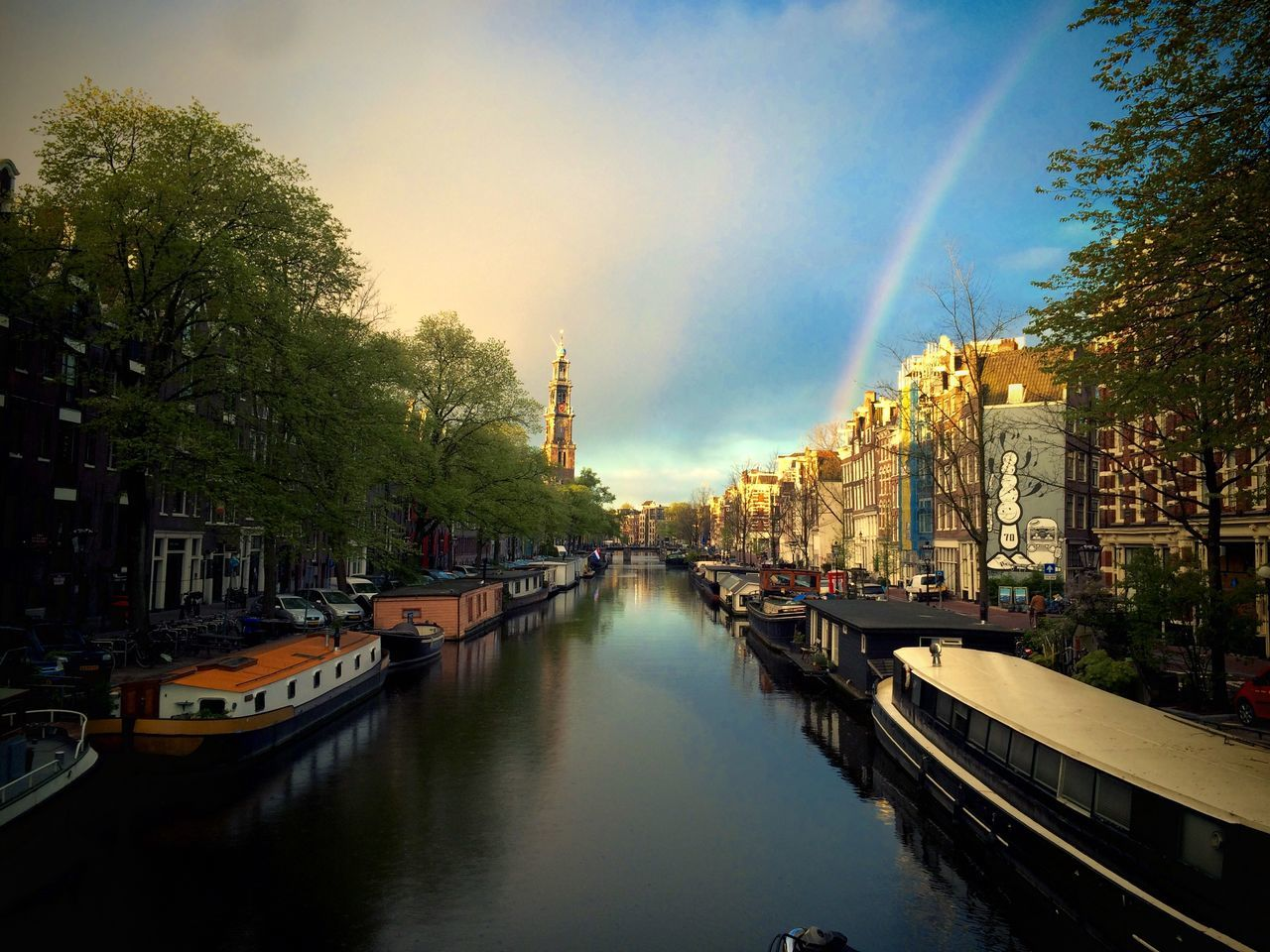 architecture, city, building exterior, built structure, canal, water, transportation, nautical vessel, no people, moored, tree, town, sky, cityscape, outdoors, day