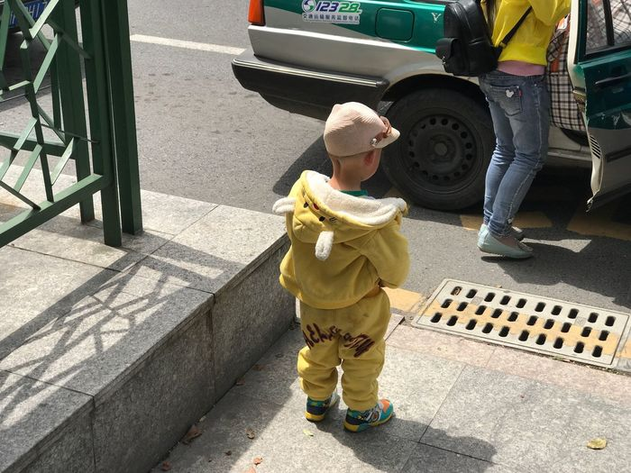A Chinese Child, Haiyan City, Zhejiang, China, April 2017. Real People Day Outdoors Sunlight Childhood Yellow Full Length Men Boys One Person Adult People