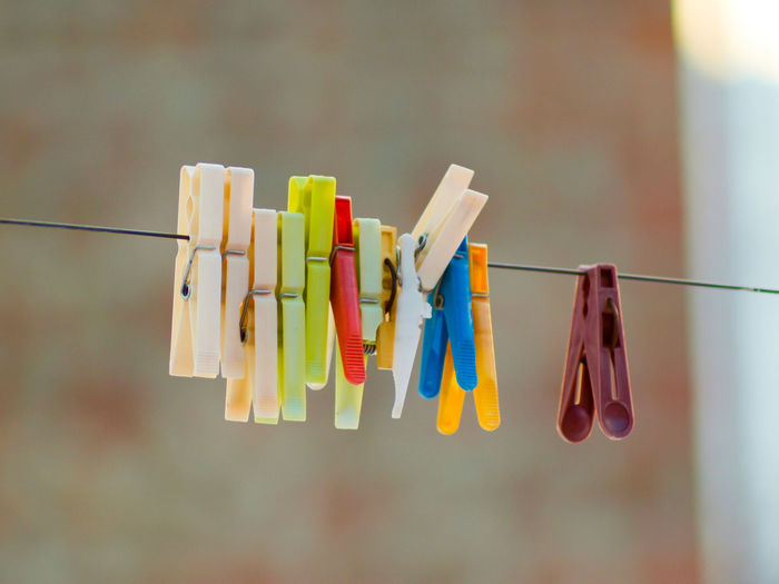 Choice Clip Close-up Clothesline Clothespin Clothing Day Focus On Foreground Group Of Objects Hanging In A Row Medium Group Of Objects Multi Colored Nature No People Rope Selective Focus Side By Side Still Life Variation