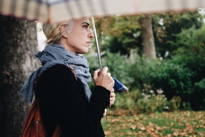 Real People Young Adult One Person Focus On Foreground Young Women Lifestyles Leisure Activity Outdoors Side View Holding Day Umbrella Rainy Days Paris France Paris, France  Portrait Candid Waiting Melancholy Woman Nature Tree Close-up People Your Ticket To Europe Mix Yourself A Good Time The Week On EyeEm