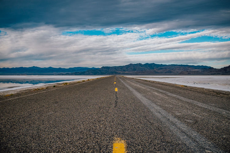 More driving, more places, be ready to go Asphalt Be. Ready. Beauty In Nature Cloud - Sky Day Drive Highway Landscape Mountain Mountain Range Nature No People Outdoors Road Scenics Sky The Way Forward