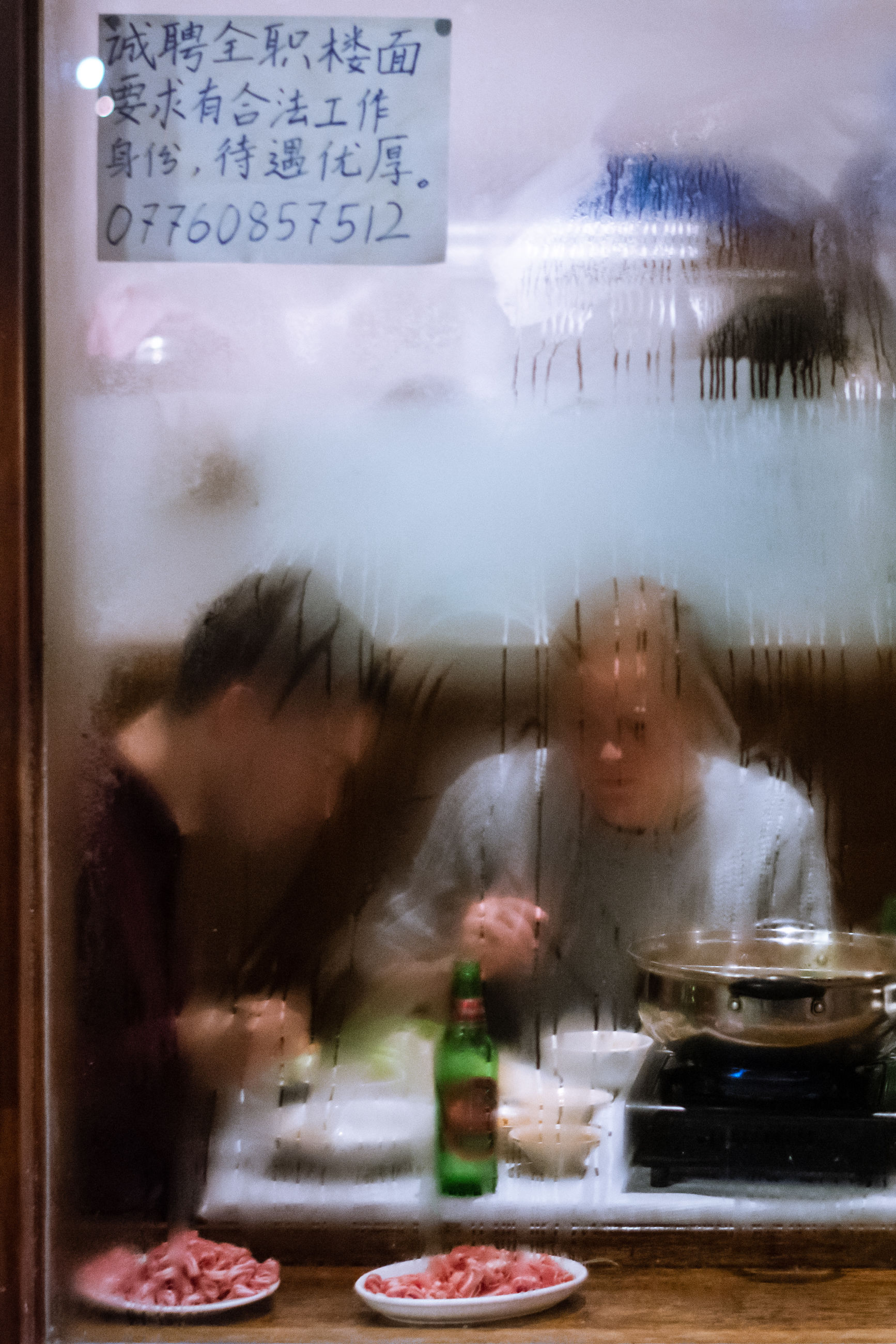 food and drink, text, food, indoors, women, real people, preparation, glass - material, lifestyles, freshness, transparent, communication, people, western script, preparing food, motion, men, table, window