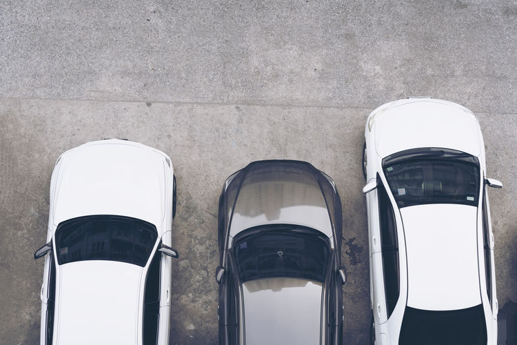 Directly above shot of car parking on road