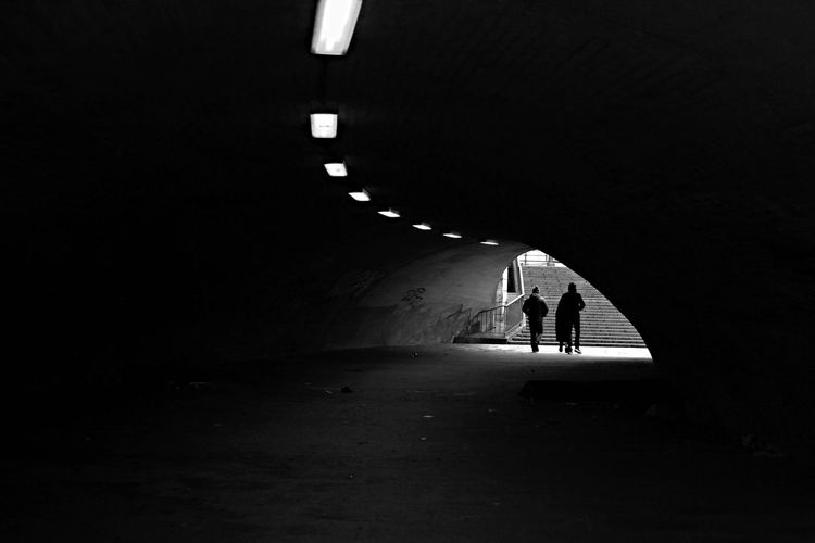 Silhouette People Walking In Underground Walkway