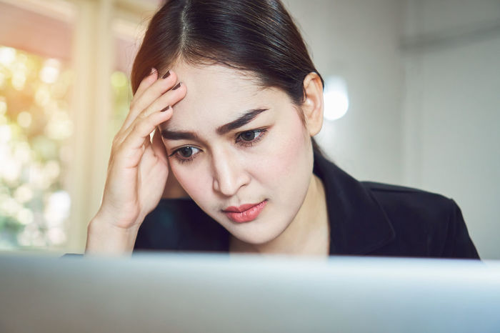 Business women sit and strain the computer screen for a long time. Because the work has been overloaded. Business Busy Employee Office Overworked Stress Student Woman Work Accountant Depressed Document Executive  Exhausted Failure  Female Frustrated Headache Job Manager Paper Paperwork Report Secretary Tired