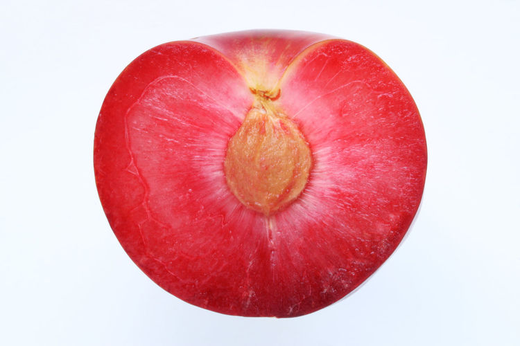 Directly above shot of red apple against white background