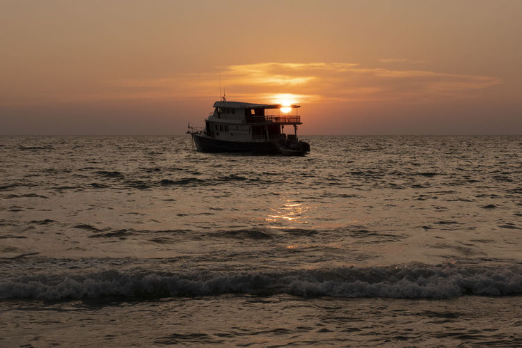 Sea Sky Sunset Water Mode Of Transportation Nautical Vessel Transportation Horizon Over Water Beauty In Nature Horizon Motion Orange Color Nature Sailing Cloud - Sky Scenics - Nature Ship Travel Beach Outdoors No People Passenger Craft Cruise Ship