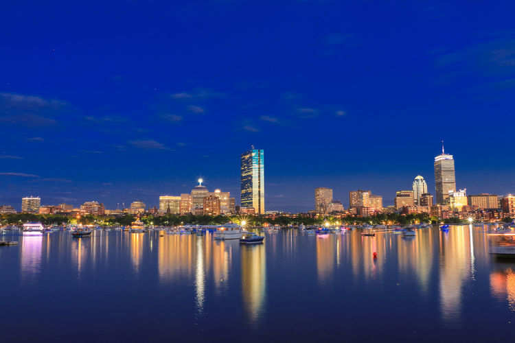 Architecture Building Exterior Built Structure City City Life Cityscape Illuminated Modern Night No People Outdoors Reflection Sea Sky Skyscraper Travel Destinations Urban Skyline Water Waterfront
