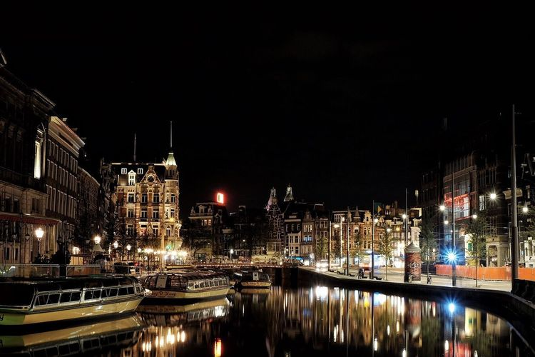 Night in amsterdam Architecture Night City Travel Destinations Mode Of Transport No People Outdoors Amsterdam Canal Nautical Vessel Transportation Building Exterior Illuminated Water Built Structure The Week On EyeEm EyeEmNewHere