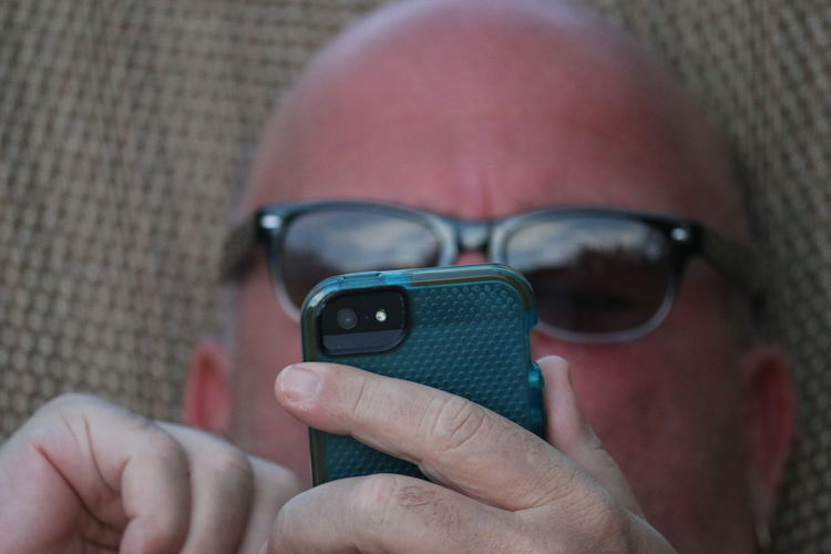 Cropped image of man using mobile phone
