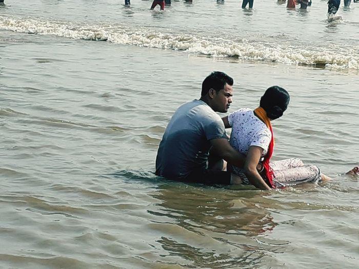 Friends at sea shore